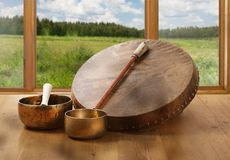 A still life of the shamanic drum and Tibetan singing bowls