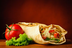 Still life with shawarma. Still life with traditional homemade shawarma and vegetables stock photo