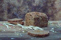 Still life- sheaf of oats, bread Royalty Free Stock Image