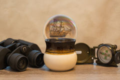 Still life with ship, binoculars, compass and cup. Dreams of traveling, still life with ship, binoculars, compass and cup Royalty Free Stock Image