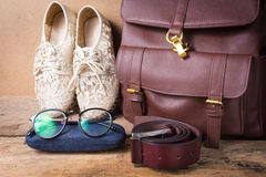 Still life of shoe with glasses,leather bag and  leather belt on Stock Photo