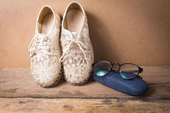 Still life of shoe with glasses on wood Royalty Free Stock Photos