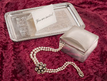Still life with silver box and tray with invitation Stock Image
