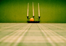 Still life: Silver candlestick and orange fruit Royalty Free Stock Photography