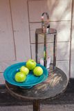 Still Life of Silver Lantern and Green Apples. Silver Lantern and Green Apples on Round Table Stock Image