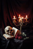 Still life with skull, book and candlestick stock photography
