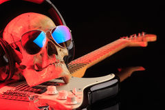 Still life with skull and electric guitar Royalty Free Stock Image