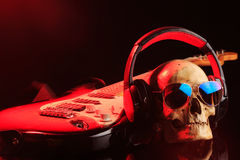 Still life with skull and electric guitar Royalty Free Stock Images