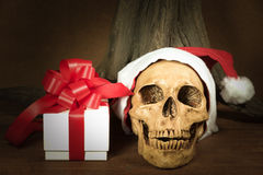 Still life with skull and present, dark concept Royalty Free Stock Image
