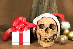 Still life with skull and present. Santa is coming to town stock images