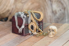 Still Life skull and small box with treasures on wooden Royalty Free Stock Images