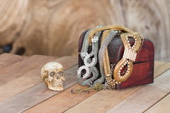 Still Life skull and small box with treasures on wooden Stock Photo