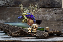 Still life skull with wine bottle Stock Photography