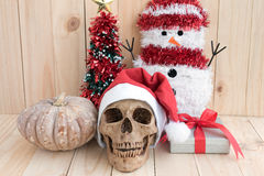 Still life with skull on wood background. Still life with skull, ornament and pumpkin, santa is coming to town royalty free stock photo