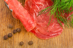 Still Life with slices of smoked meat Stock Image