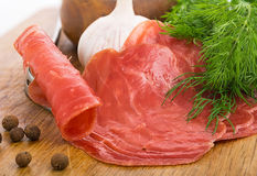 Still Life with slices of smoked meat Royalty Free Stock Photos