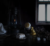 Still life. Small Dutch. kerosene lamp with purified lemon and sugar on a wooden table against the window. Still life. kerosene lamp with purified lemon and Stock Photography