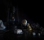 Still life. Small Dutch. kerosene lamp with purified lemon and sugar on a wooden table   dark background. Still life. kerosene lamp with purified lemon and sugar Royalty Free Stock Photography