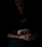 Still life in the small Dutch-style. a woman holding  tray of bread. vintage Stock Photos
