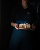 Still life in the small Dutch-style. a woman holding  tray of bread. vintage Royalty Free Stock Photography