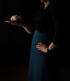 Still life in the small Dutch-style. a woman holding  tray of bread. vintage Royalty Free Stock Photos