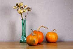 Still life with small pumpkins and a bouquet Royalty Free Stock Photography