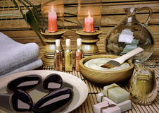 The still life Spa with aromatic oil, candles, a lotus flower, b Stock Image