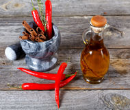 Still-life of spice and mortar on a old table Stock Image