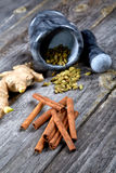 Still-life of spice and mortar on a  table Stock Photography