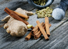 Still-life of spice and mortar on a table Royalty Free Stock Photo