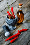 Still-life of spice and mortar on a wooden table Royalty Free Stock Photography