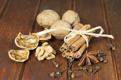 Still life with spice and nuts on a wooden table Royalty Free Stock Images