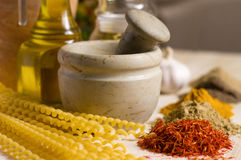 Still life with spices, macaroni and mortar Royalty Free Stock Image