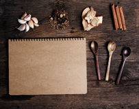 Still life with spices and notebook paper on wood Stock Photos