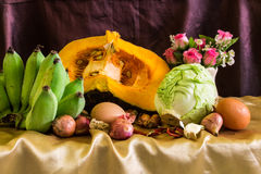 Still life split pumpkin, Vegetable and eggs Stock Image