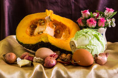Still life split pumpkin, Vegetable and eggs Royalty Free Stock Image