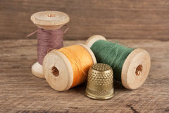 Still life of spools of thread. On a wooden background Stock Photography