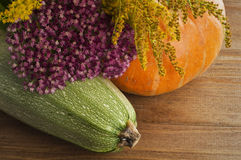 Still life of squash, pumpkins and flowers Royalty Free Stock Photos