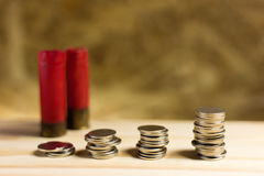 Still life.Staircase of money, Thai coins of one bath on wood. And Shotgun shell background.Concept of financial planning and savings Stock Photography