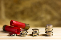 Still life.Staircase of money, Thai coins of one bath on wood an. D Shotgun shell background.Concept of financial planning and savings Royalty Free Stock Photos