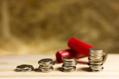 Still life.Staircase of money, Thai coins of one bath on wood an. D Shotgun shell background.Concept of financial planning and savings Royalty Free Stock Image