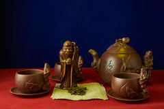 Still life with a statuette of the god of tea Royalty Free Stock Photography