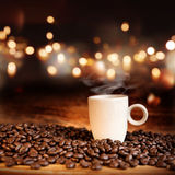 Still life with a steaming coffee cup Royalty Free Stock Photo