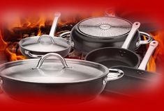 Still life of steel pots with flames and red background. stock image