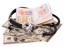 Still life with stethoscope, money and passport Royalty Free Stock Photo
