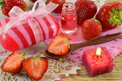 Still life with straberry perfume and oil Stock Photography
