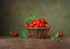 Still life with strawberries in a basket Royalty Free Stock Photography