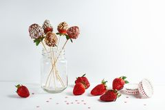 Still life of strawberries in chocolate royalty free stock photo