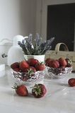 Still life with strawberries and flowers Stock Photos