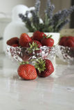 Still life with strawberries and flowers Royalty Free Stock Photos
